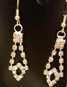 Lovely rhinestone earrings to match the beautiful rhinestone bracelet. These items are not made by E.